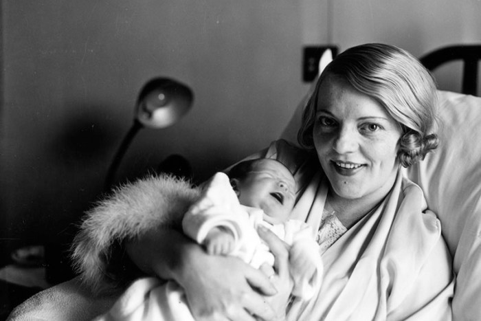 Mrs. Mickey Walker and her newborn baby