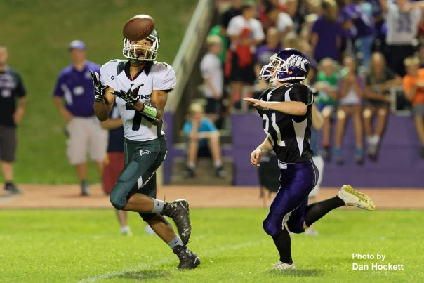 Photo by Dan Hockett West Burlington – Notre Dame Wide Receiver Rel Greer (7) catches a pass in front of Keokuk's Matt Wyatt (31) then runs for a 53-yard touchdown to put the Falcons on the scoreboard first Friday night in Keokuk. Keokuk defeated WBND, 24-21.