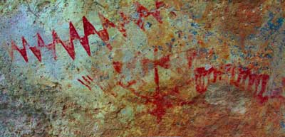 A rock art panel found at Dripping Springs, New Mexico depicts abstract triangle motifs. At this panel and others like it, potent wild tobacco was found growing beneath the image. Photograph enhanced with DStretch. (Courtesy L. Loendorf)