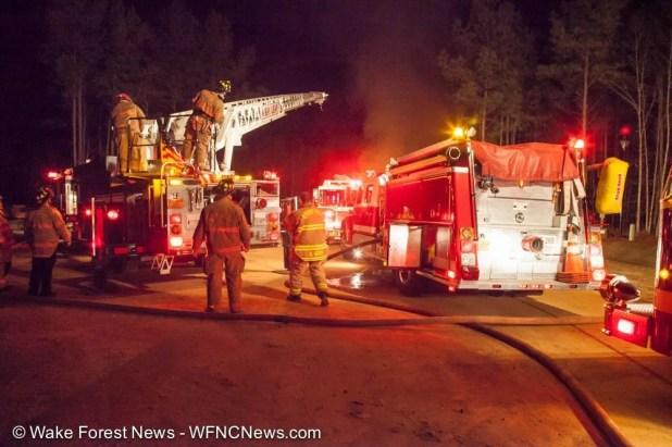 A Bay Leaf Fire Department ladder truck and Stony Hill pumper truck are just some of the 15 or more fire trucks that crowded in to fight the house fire.