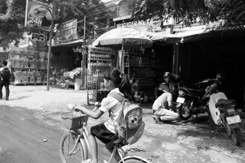 Cambodian Girl Riding Bike