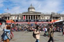 The excited public begin to enter Trafalgar Square