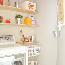 Laundry room with red accents