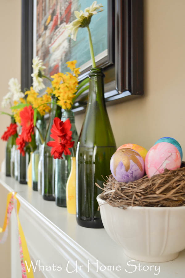 Use old botles as vases for a simple Spring mantel