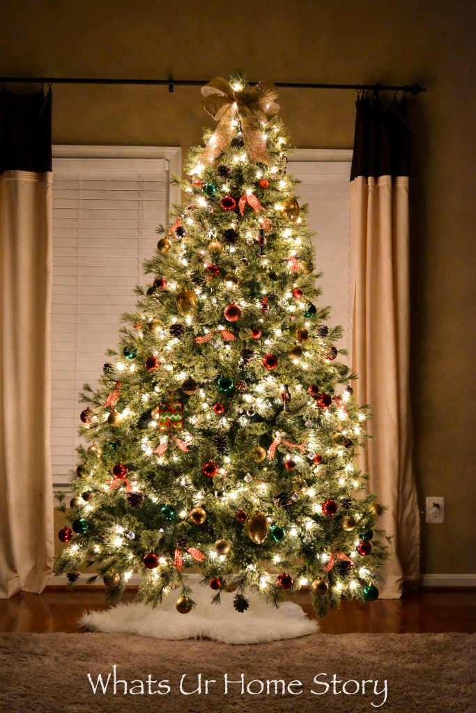 Christmas Tree with ornaments and a bow tree topper