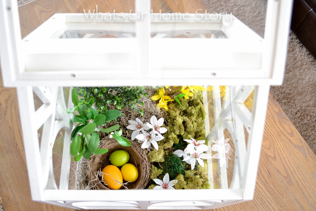 Spring terrarium using dried moss, silk flowers, and Easter eggs
