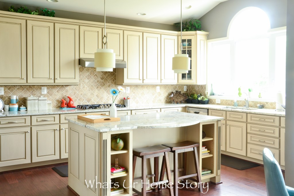 Kitchen with white cabinets and large island