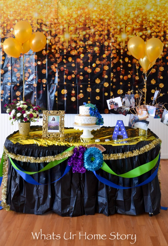Cake table for 40th birthday party with an amazing photo backdrop-milestone birthday party decor