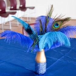 DIY glitter jar peacock feather arrangement from an old bottle