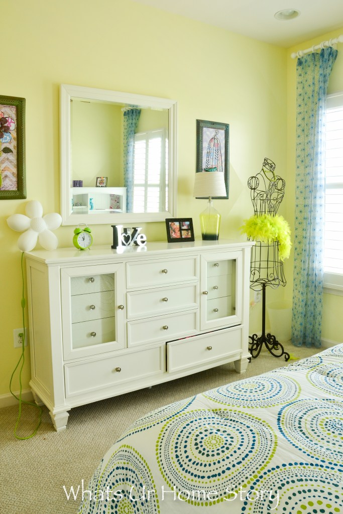 blue and green girls room in a neutral and eclectic home.