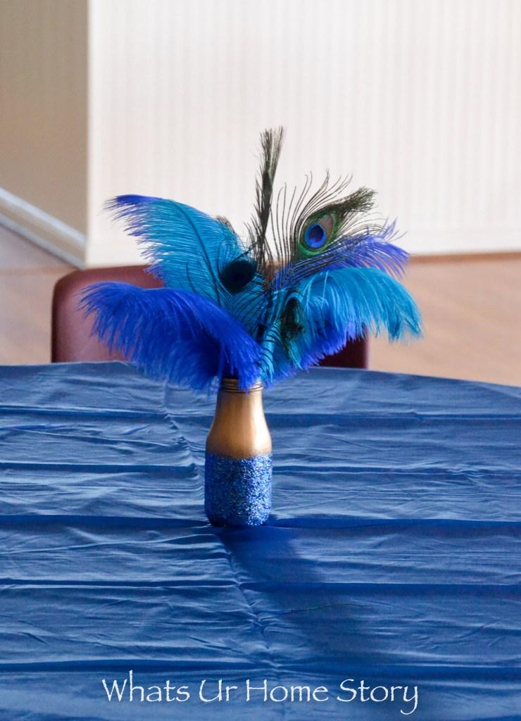 glitter vase peacock centerpiece for a peacock theme party or wedding