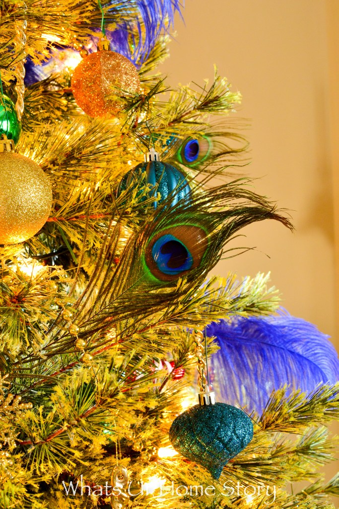 peacock-themed-christmas-tree-in-blue-gold-and-green-colors
