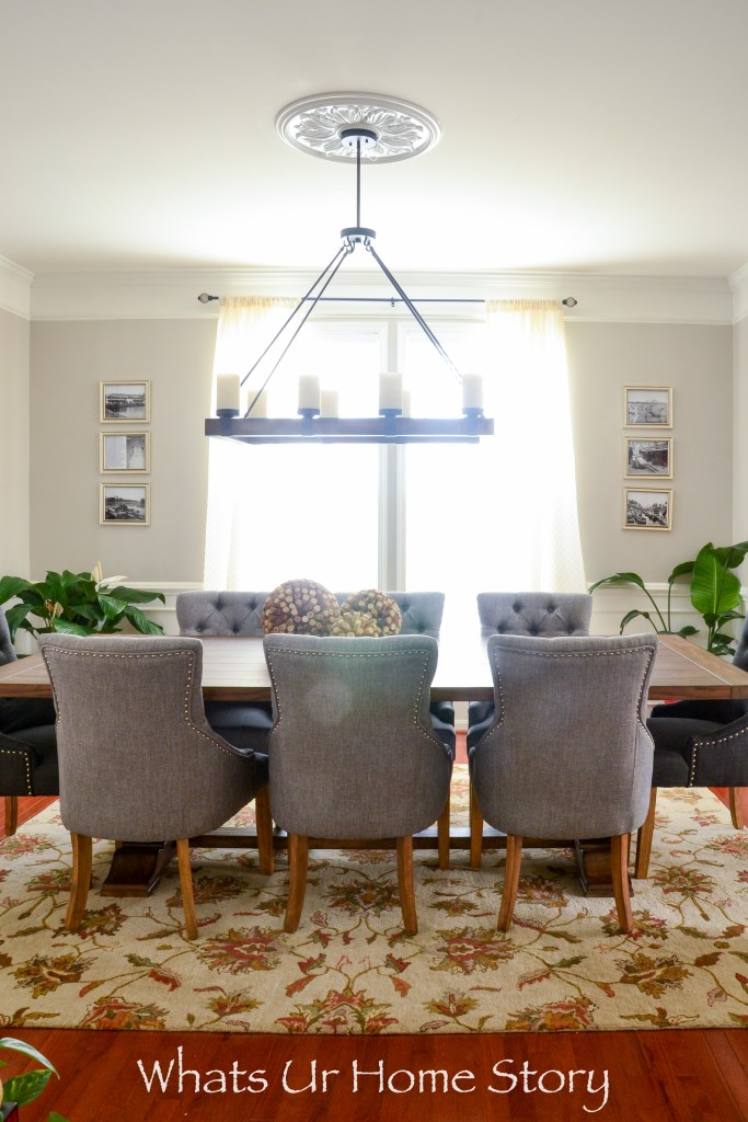 Elegant Dining Room Ideas - Trnasitional Dining room with tufted chairs, rustic table, and large chandelier -Benjamin Moore Revere Pewter wall color