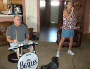 Mom and dad playing RockBand