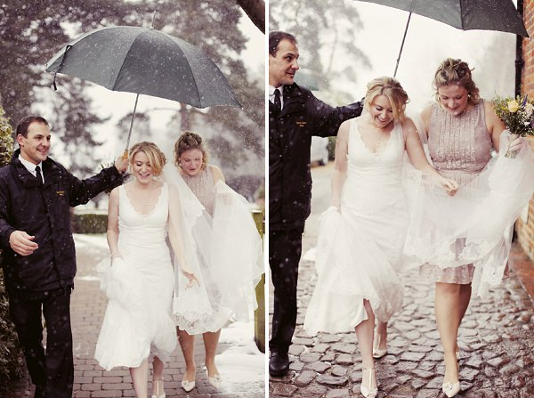 bride arrival umbrella snow