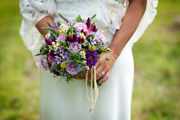 purple wedding bouquet http://www.photographer-north-wales.com/