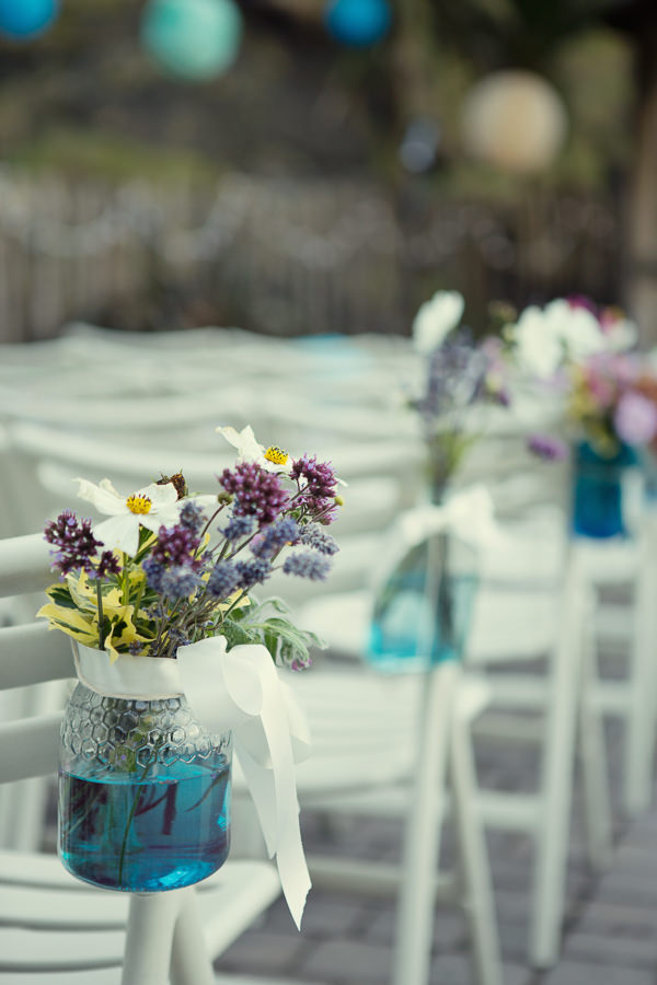 Magical Turquoise Beach Wedding Aisle Jar Flowers http://www.mariannetaylorphotography.co.uk/