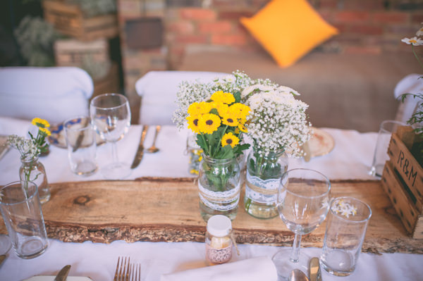Country Rustic Yellow Barn Wedding Log Table Setting Centres http://www.sophieduckworthphotography.com/