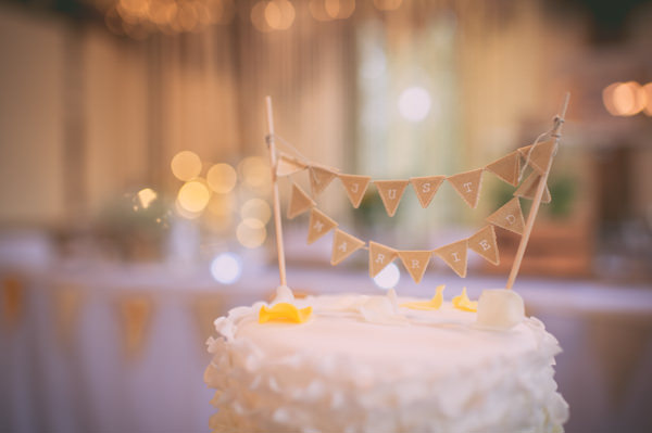 Country Rustic Yellow Barn Wedding Bunting Cake Topper http://www.sophieduckworthphotography.com/