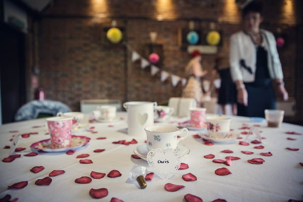 Small Village Hall Tea Cup Rose Petals Wedding http://assassynation.co.uk/