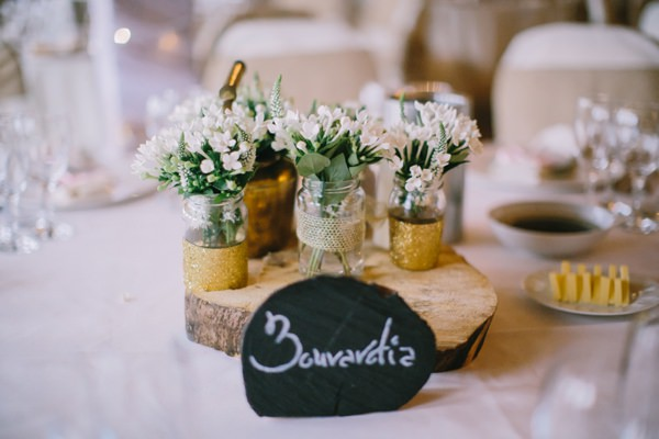 Stylish White DIY Floral Filled Barn Wedding Glitter Jar Flowers http://www.chrisbarberphotography.co.uk/