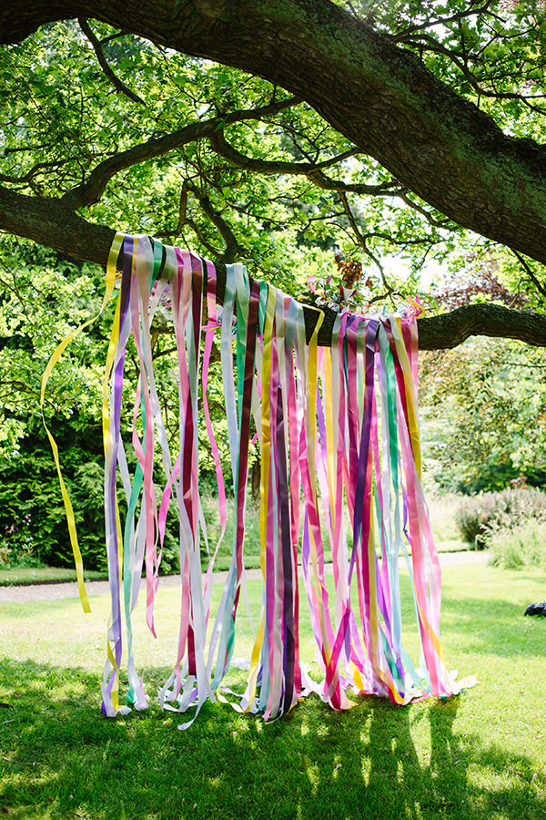 Ribbon Backdrop Colourful Outdoor Blooms Ribbons Wedding Ideas http://www.paperangelphotography.co.uk/