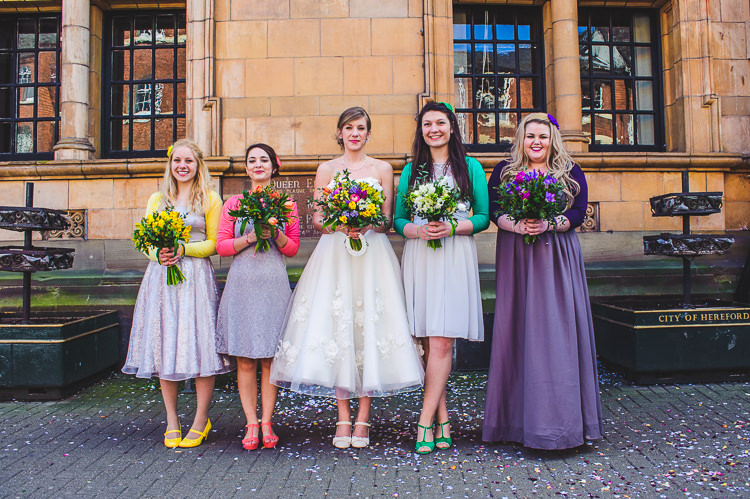 Rainbow Mismatched Bridesmaid Lilac Purple Dresses Cardigans Bright Multicolour DIY Skater Village Hall Herefordshire Wedding http://www.robfarrellphotography.co.uk/