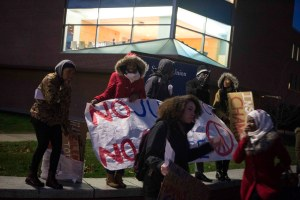 Students gather on Fairfield Way before marching to Gully Hall.