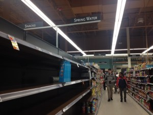 """The """"spring water"""" shelves were cleared out by 4 p.m. on Monday. (Photo by Sylvia Cunningham)"""
