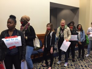 Students prepare to go into the Board of Trustees meeting. (Photo by Sylvia Cunningham)