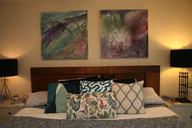 I love lots of pillows...David tolerates lots of pillows...and I made the art with some acrylics that I let get runny and wet; my representation of the cosmos.