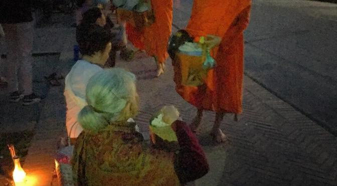 The most sacred Lao traditions, the Buddhist Alms Giving Ceremony. Where the locals line up to get blessing from the monks by offering their meal for the day.  #Laos #LuangPrabang
