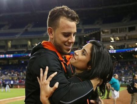 Miami Marlins pitcher Jose Fernandez, left, was pictured embracing girlfriend Carla Mendoza after defeating the Atlanta Braves 12-11 in a baseball game on September 25, 2015.