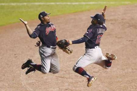 Francisco Lindor and Rajai Davis (20) of the Cleveland Indians celebrate after defeating the Chicago Cubs 1-0 in Game 3 of the 2016 World Series at Wrigley Field on Oct. 28, in Chicago, Ill.