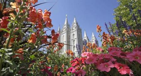 FILE - This Aug. 4, 2015, file photo, flowers bloom in front of the Salt Lake Temple, at Temple Square, in Salt Lake City. In 15 videos posted online Sunday, Oct. 2, 2016, during the final day of the religion's twice-yearly conference, Mormon leaders discussed concerns about the growth of the gay rights movement and heard from a former U.S. senator and church member who tells them the Iraq war could open the door for new converts, according to the  footage that pulls back the curtain on a religion that is closely guarded about its inner workings. (AP Photo/Rick Bowmer, File)