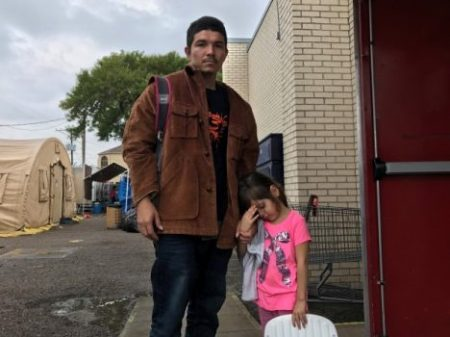 Ever Javier Palma Romero, 24, a fish processor from coastal El Salvador, with his daughter, Jackeline, 4, says he faced gang threats in his home town and decided to flee to the United States. (Josh Partlow/The Washington Post)