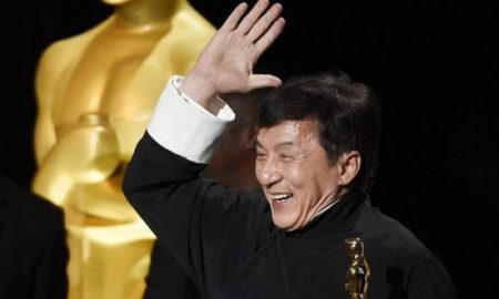 Jackie Chan with his Oscar. Photograph: Chris Pizzello/Invision/AP