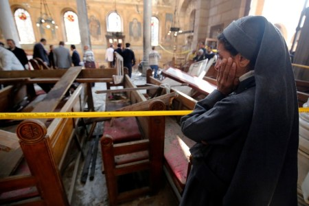 A nun cries as she stands at the scene inside Cairo's Coptic cathedral, following a bombing, in Egypt December 11, 2016.