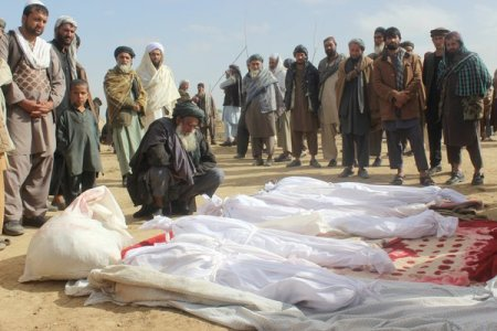 Villagers gathering around some of those who were killed during heavy fighting in Boz Qandahari, in Kunduz Province, in November. (Najim Rahim/Associated Press)