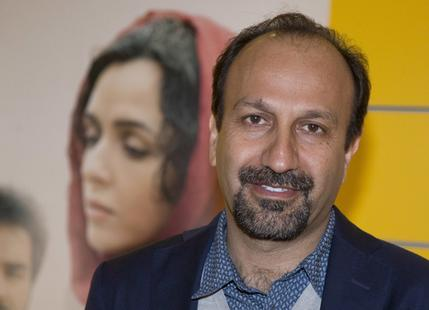 """FILE -- In this Oct. 10, 2016 file photo, Iranian director Asghar Farhadi poses for a photo during the premiere of his film, """"The Salesman, in Paris. Iran's top diplomat has congratulated director Asghar Farhadi for winning the Oscar in the best foreign language category with his film """"the Salesman."""" Mohammad Javad Zarif saw the prize as a move against President Donald Trump's effort to bar U.S. entry to citizens from seven majority Muslim countries, including Iran. Zarif tweeted: """"Proud of Cast and Crew of """"The Salesman"""" for Oscar and stance against #MuslimBan. Iranians have represented culture and civilization for millennia."""" (AP Photo/Michel Euler, File)"""