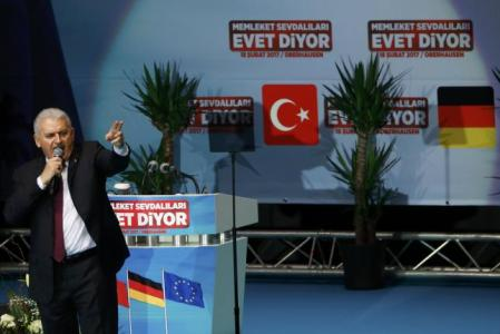Turkish Prime Minister Binali Yildirim addresses a crowd in Oberhausen, Germany, February 18, 2017, to promote Turkey's constitution referendum on April 16, 2017.      REUTERS/Wolfgang Rattay