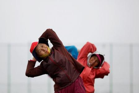 FILE PHOTO:  Elderly residents exercise on the island of Yeonpyeong, which lies in the Yellow Sea, South Korea, April 9, 2014. REUTERS/Damir Sagolj/File Photo