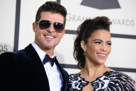 Robin Thicke and Paula Patton's messy custody war continues. Cops were called once again on the pair after Patton was supposed to hand over their son to Thicke. (JORDAN STRAUSS/J INVISION/AP)