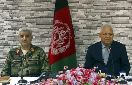 Afghanistan's Defense Minister Abdullah Habibi, right, and Army Chief of Staff Qadam Shah Shahim give a press conference, in Kabul, Afghanistan, Monday, April 24, 2017. Habibi and Shahim resigned on Monday, following a Taliban attack over the weekend that struck a northern army base, killing more than 100 military and other personnel. (AP Photo/Massoud Hossaini)