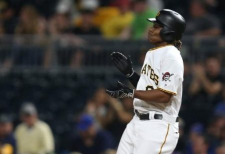 Pittsburgh Pirates second baseman Gift Ngoepe (61) reacts after recording his first major league hit against the Chicago Cubs during the fourth inning at PNC Park. Credit: Charles LeClaire-USA TODAY Sports