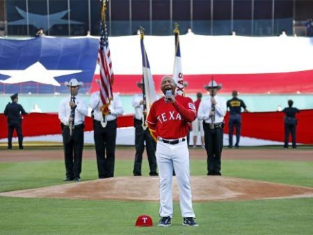 Texas Rangers third base coach Tony Beasley sings the national anthem before the team's opening-day game against the Cleveland Indians on April 3, 2017. Photo courtesy of Louis DeLuca/Texas Rangers
