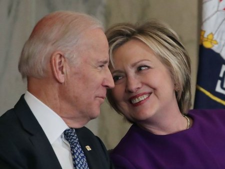WASHINGTON, DC - DECEMBER 08:  Former US Secretary of State, Hillary Clinton shares a laugh with US Vice President Joseph Biden, during a portrait unveiling ceremony for outgoing Senate Minority Leader Harry Reid (D-NV), on Capitol Hill December 8, 2016 in Washington, DC.  (Photo by Mark Wilson/Getty Images)