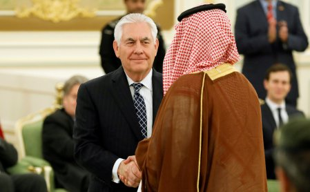 FILE PHOTO: U.S. Secretary of State Rex Tillerson (C) shakes hands with a participant as he attends a signing ceremony between U.S. President Donald Trump and Saudi Arabia's King Salman bin Abdulaziz Al Saud at the Royal Court in Riyadh, Saudi Arabia May 20, 2017. REUTERS/Jonathan Ernst/Files