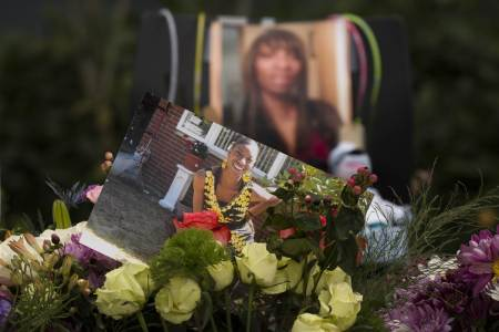 Flowers, photos, and other items are placed at a memorial for Charleena Lyles at the apartment building in which she was killed by police on June 20, 2017 in Seattle, Washington. (David Ryder / Getty Images)