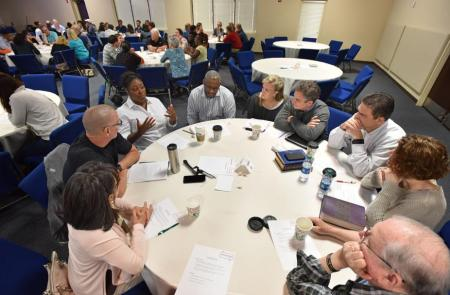 "Clockwise from left, Mary Louise and Stephen Gilkenson, Corliss and Melvin Kinard, Denise and Mike Moss, Eric and Becca Anderson, and Myles Lorenzen discuss during a ""Grace and Race"" seminar at Eagles Nest Church in Roswell on Saturday, May 6, 2017. (HYOSUB SHIN / HSHIN@AJC.COM)"
